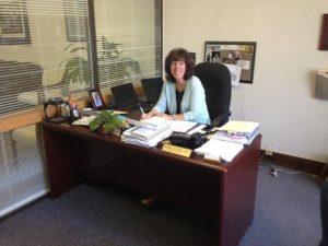 Ilene Stern sitting at a desk