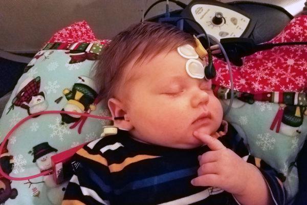 Newborn hearing evaluation via auditory brainstem response (ABR) testing.