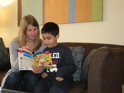 Sarah reads to a boy