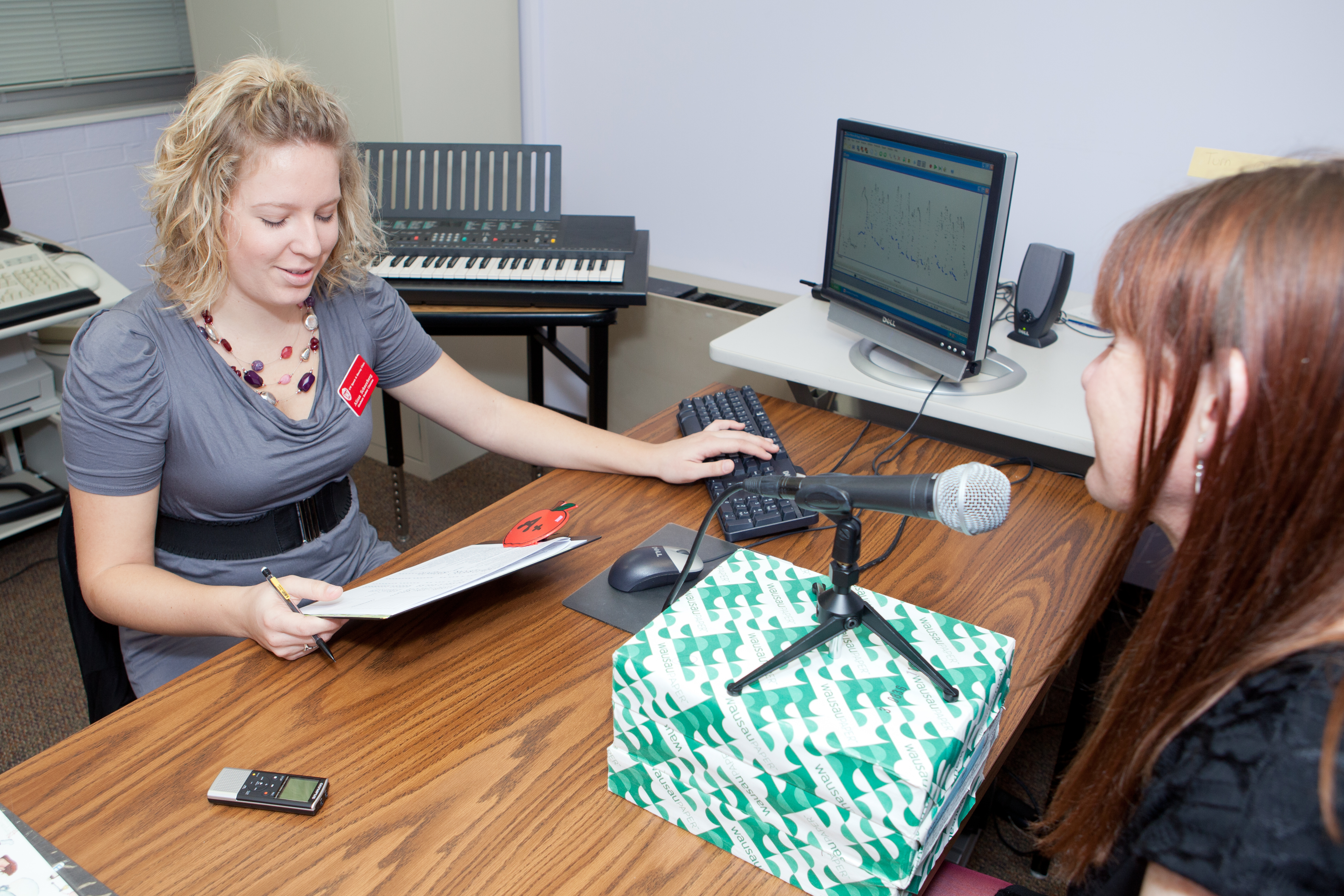 Student clinician working with a client during a voice session.
