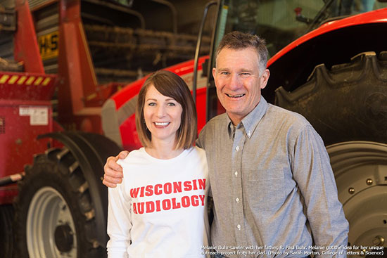 Melanie Buhr-Lawler on the farm with her father.