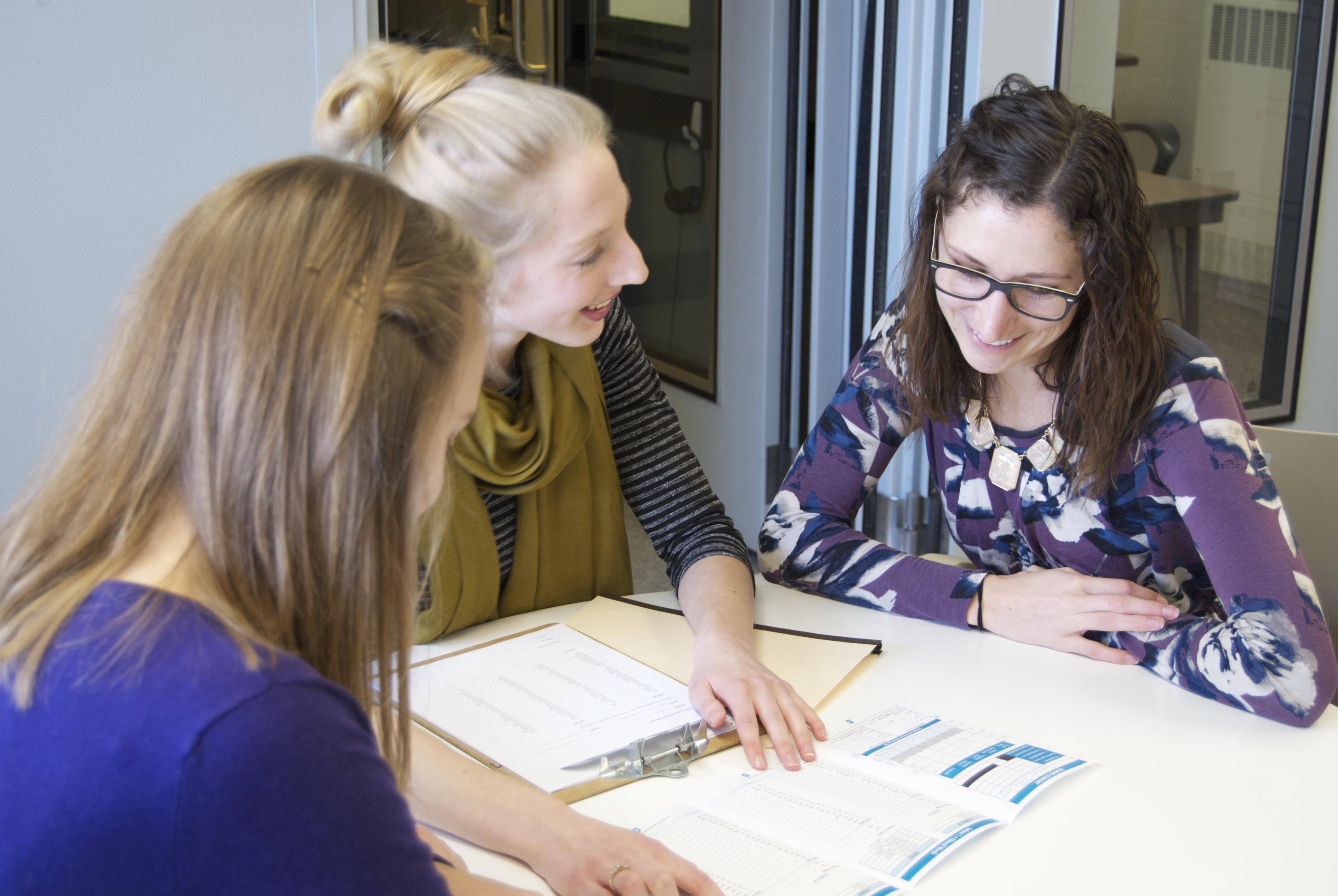 Graduate audiology student clinicians work on a CAPD team.