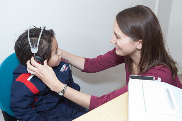 Dane County Head Start participant receives a hearing screening from one of the graduate student clinicians.