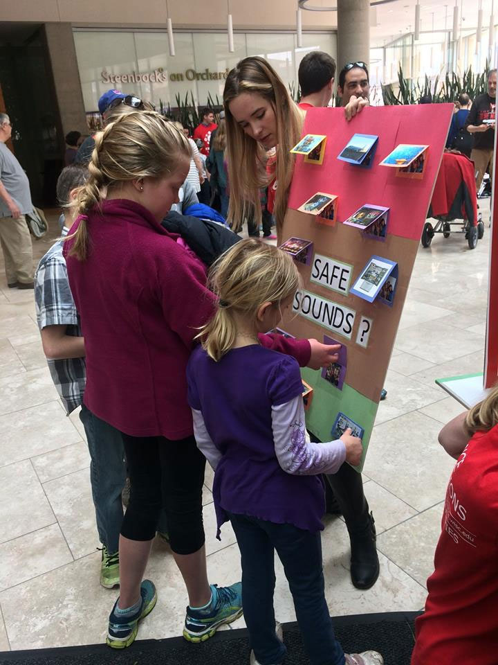 Au.D. student educating children on safe sounds at the UW Madison Science Expeditions.