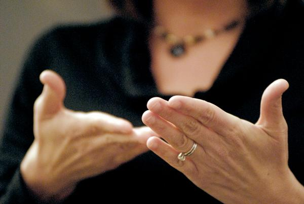 Hands of a sign language translator.