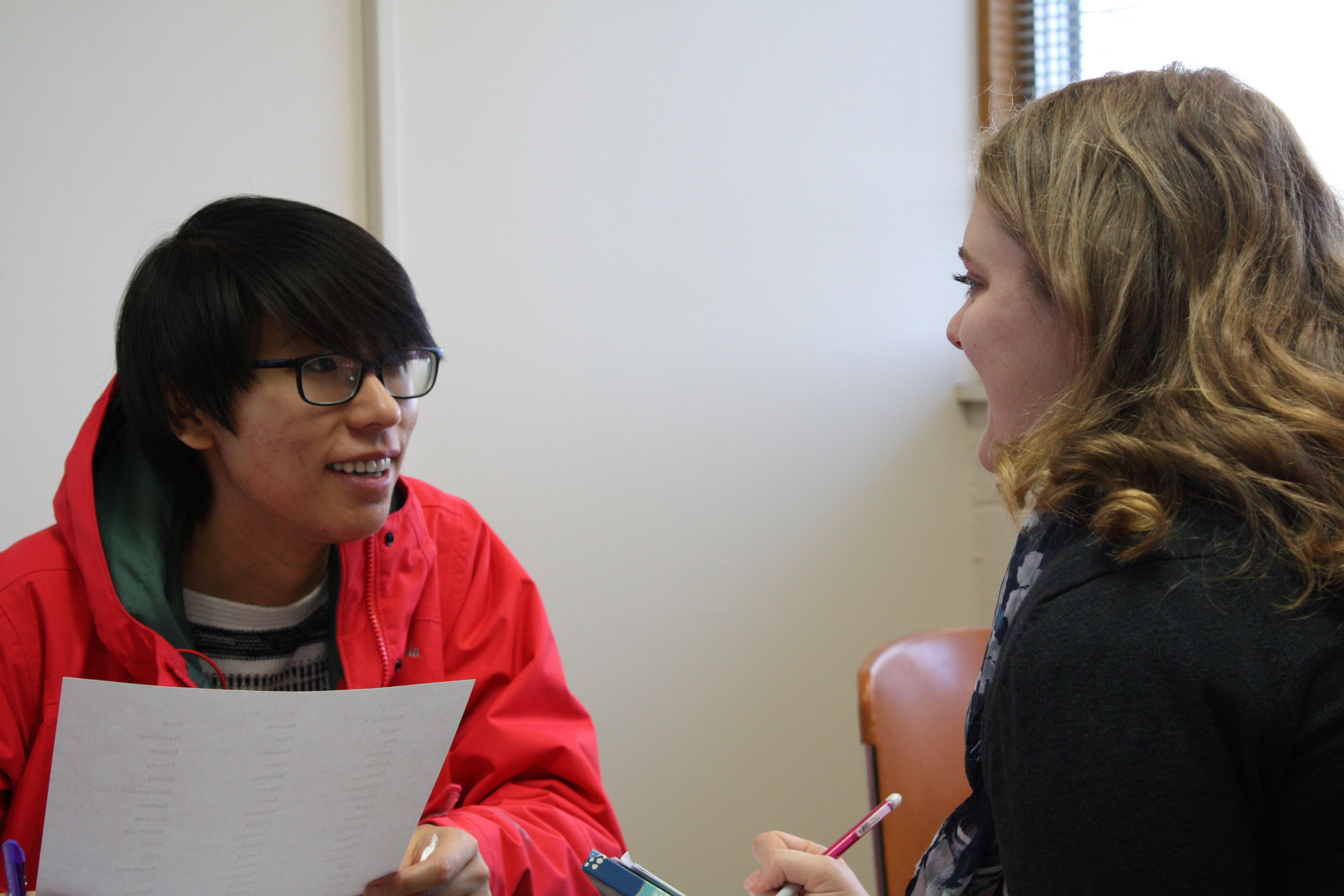 Student clinician working with a client on a voice exercise.