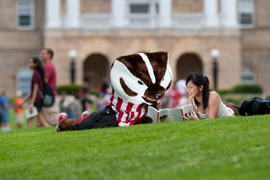 Bucky Reads with a Student on Bascom Hill