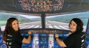 Kim Caul and Alyson Eith visit the simulation cockpit.