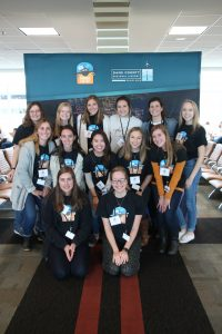 UW-Madison graduate students and faculty group photo at the Dane County Airport