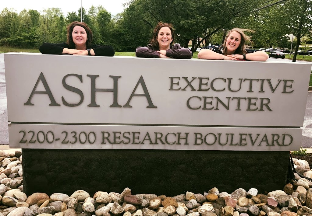 Alyson Eith and Abygail Marx pose next to the ASHA building sign.