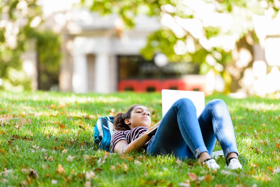Undergraduate Ellie Shelp enjoys a mild autumn day as she studies outdoors with her laptop computer on Bascom Hill at the University of Wisconsin-Madison on Oct. 11, 2016. (Photo by Jeff Miller/UW-Madison)