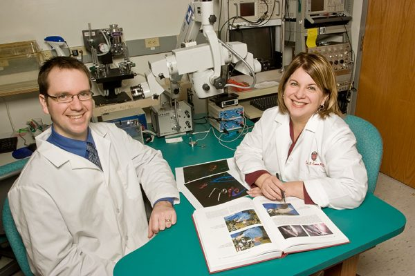 Nadine Connor and Aaron Johnson review neuromuscular junction morphology in the lab.